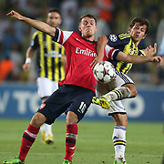 Fenerbahce's Emre Belozoglu and Arsenal's Ramsey during the UEFA Champions League Play-Offs First leg soccer match Fenerbahce between Arsenal at Sukru Saracaoglu stadium in Istanbul Turkey on Wednesday 21 August 2013. Photo by TURKPIX