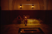 Two men sit together after a massage and a bath by a masseur in the Hammam Yalbougha an-Nasry inside the Souk in Aleppo. Originally constructed in 1491, it is one of Syria's finest working bathhouses.