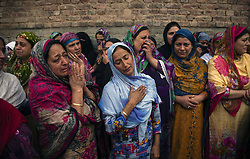 October 5, 2018 - Srinagar, Jammu and Kashmir, India - Neighbors and relatives mourn on seeing the body of Nazir Ahmad one of the members of the regions oldest pro India political party, the National conference, killed by unidentified gunmen, during his funeral. Two members of the regions oldest pro India political party, the National conference (NC), were shot dead. (Credit Image: © Yawar Nazir/ZUMA Wire)