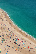 The beach in summer in Nazare, Portugal.