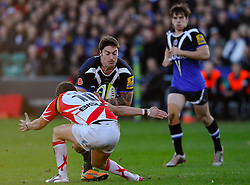 Bath Inside Centre (#12) Matt Banahan runs at Dragons Fly-Half (#10) Steffan Jones on his way to scoring a try during the second half of the match - Photo mandatory by-line: Rogan Thomson/JMP - Tel: Mobile: 07966 386802 09/11/2012 - SPORT - RUGBY - The Recreation Ground - Bath. Bath v Newport Gwent Dragons  - LV= Cup