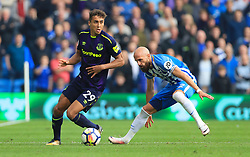 """Everton's Dominic Calvert-Lewin (left) and Brighton & Hove Albion's Bruno battle for the ball during the Premier League match at the AMEX Stadium, Brighton. PRESS ASSOCIATION Photo. Picture date: Sunday October 15, 2017. See PA story SOCCER Brighton. Photo credit should read: Gareth Fuller/PA Wire. RESTRICTIONS: EDITORIAL USE ONLY No use with unauthorised audio, video, data, fixture lists, club/league logos or """"live"""" services. Online in-match use limited to 75 images, no video emulation. No use in betting, games or single club/league/player publications."""