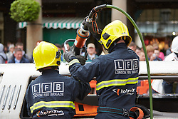 © Licensed to London News Pictures.  14/05/2013. LONDON, UK. Members of the London Fire Brigade extraction team, consisting of training officers and London based firefighters, demonstrate the difficulties associated with rescuing simulated casualties from a stretched limousine. The vehicles are an increasingly common sight on UK roads but the majority have failed safety inspections. Despite being one of the best performing crews in the country it still took 45 minutes to rescue just three people and complete the exercise.  Photo credit: Cliff Hide/LNP