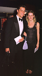 MISS EMMA PARKER BOWLES and MR ANDREW WINTERTON, at a film premier on 26th August 1998.MJL 48