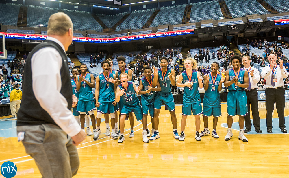 Cox Mill celebrates winning the NCHSAA 3A State Championship game against Eastern Guilford at the Dean Smith Center in Chapel Hill. Cox Mill won the game 70-66