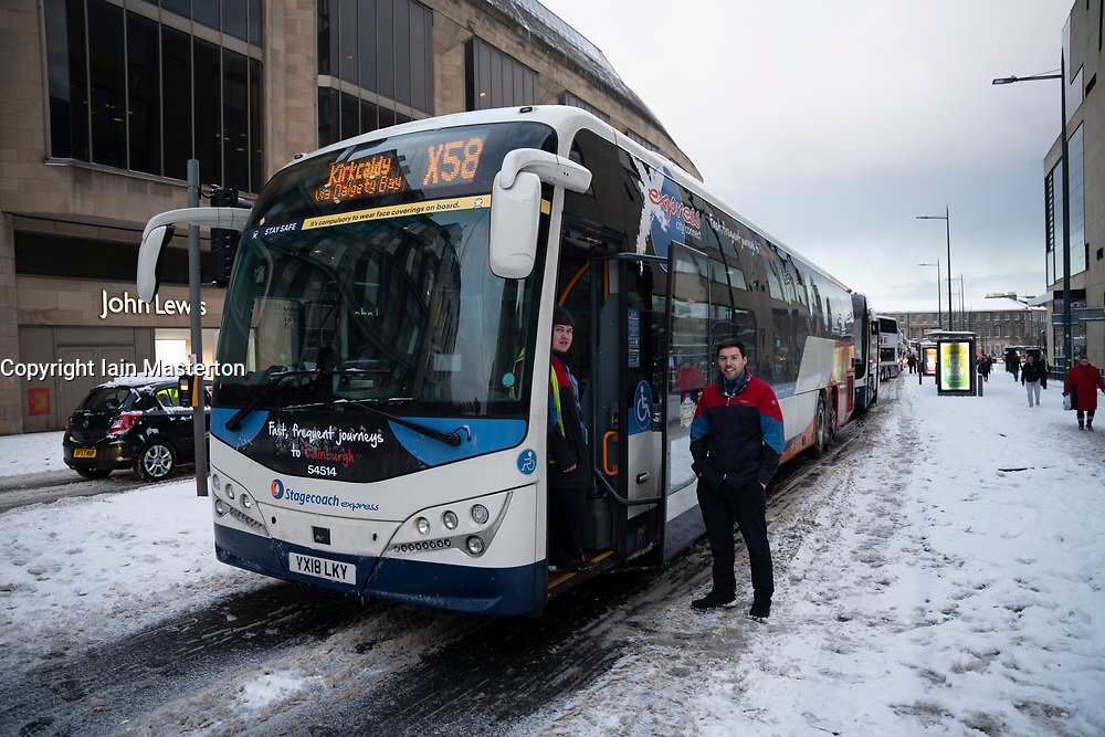 Edinburgh, Scotland, UK. 10 Feb 2021. Big freeze continues in the UK with heavy overnight and morning snow bringing traffic to a standstill on many roads in the city centre. Pic; Stagecoach bus drivers pass the time waiting for road to clear on Leith Walk.  Iain Masterton/Alamy Live news