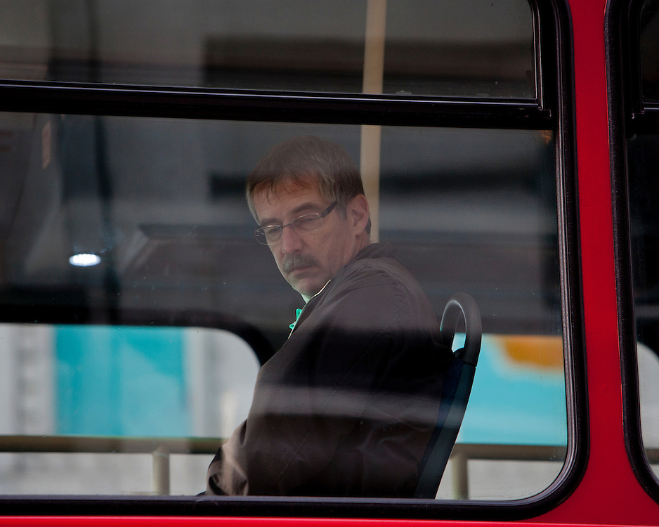 Man on a London Bus looking down