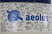 Mcc0084404 . Daily Telegraph<br /> <br /> Aeolus Satellite Launch<br /> <br /> Messages on the side of the Vega rocket fuelled and ready to launch with it's Aeolus Satellite payload at the European Space Centre in French Guiana  . <br /> The Aeolus Satellite, designed and built by Airbus in Stevenage, England contains pioneering technology that will monitor winds around the globe that will change weather forecasting forever .<br /> <br /> Kourou, French Guiana 21 August 2018