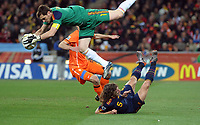 Soccer City Johannesburg Spain v Holland Match 64 World Cup Final  11/07/2010<br /> Iker Casillas (Spain) collects under pressure from Robin van Persie  (Holland) with Carlos  Puyol in support<br /> Photo Roger Parker Fotosports International