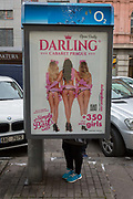 An adult-themed mens cabaret entertainment ad on the side of a phone kiosk, on 17th March, 2018, on Vodickova Street, in Prague, the Czech Republic.