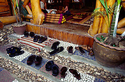 Tourist's sandals outside a bar and hotel on the island of KohPangan, Thailand