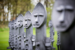 © Licensed to London News Pictures. 07/04/2017. Wakefield UK. Artist Zak Ove's 80 identical 2 metre tall graphite figures called Black & Blue: The invisible Man & the Masque of Blackness that are now on show at Yorkshire Sculpture Park. Photo credit: Andrew McCaren/LNP