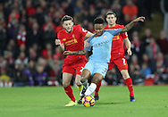 Adam Lallana of Liverpool and Raheem Sterling of Manchester City during the English Premier League match at Anfield Stadium, Liverpool. Picture date: December 31st, 2016. Photo credit should read: Lynne Cameron/Sportimage