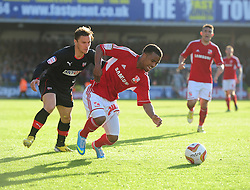 Swindon Town's Nathan Byrne is fouled by Brentford's Sam Saunders - Photo mandatory by-line: Joe Meredith/JMP - Tel: Mobile: 07966 386802 04/05/2013 - SPORT - FOOTBALL - County Ground - Swindon - Swindon Town v Brentford - Npower League one Play Off
