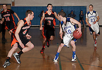 Farmington's Jase Gregoire and Tanner Gibbs keeps the pressure on Winnisquam's Normand Tucker during NHIAA DIvision III basketball Thursday evening.  (Karen Bobotas/for the Concord Monitor)
