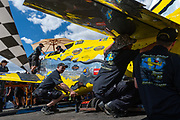 The Precious Metal team scramble to check and recheck every inch of the plane before each run during the 2015 Reno Air Races.
