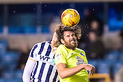 Peterborough United midfielder Michael Bostwick (4), Millwall forward Harry Smith (30) during the EFL Sky Bet League 1 match between Millwall and Peterborough United at The Den, London, England on 28 February 2017. Photo by Sebastian Frej.
