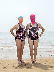 June 29, 2017 - Tsingtao, China - Cautious beach lovers have taken sun protection to another level by donning the face-kini as summer heat sweeps China. The garments range in price from 15 to 20 yuan, with retired women being major buyers. The swimmers said the masks can also provide protection from jellyfish stings. (Credit Image: © Peng Yangjun/SIPA Asia via ZUMA Wire)