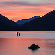 A vivid sunset at Harrison Lake near Harrison Hot Springs, British Columbia, Canada. The distant mountains are Sasin Peak and Deroche Mountain.