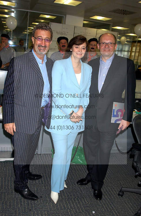 Left to right, EDDIE JORDAN, CHERIE BLAIR and MICHAEL SPENCER at the annual ICAP charity day - where all the trading profit made by City firm ICAP are donated to charity, held at their offices at 2 Broadgate, City of London on 7th December 2005.<br />