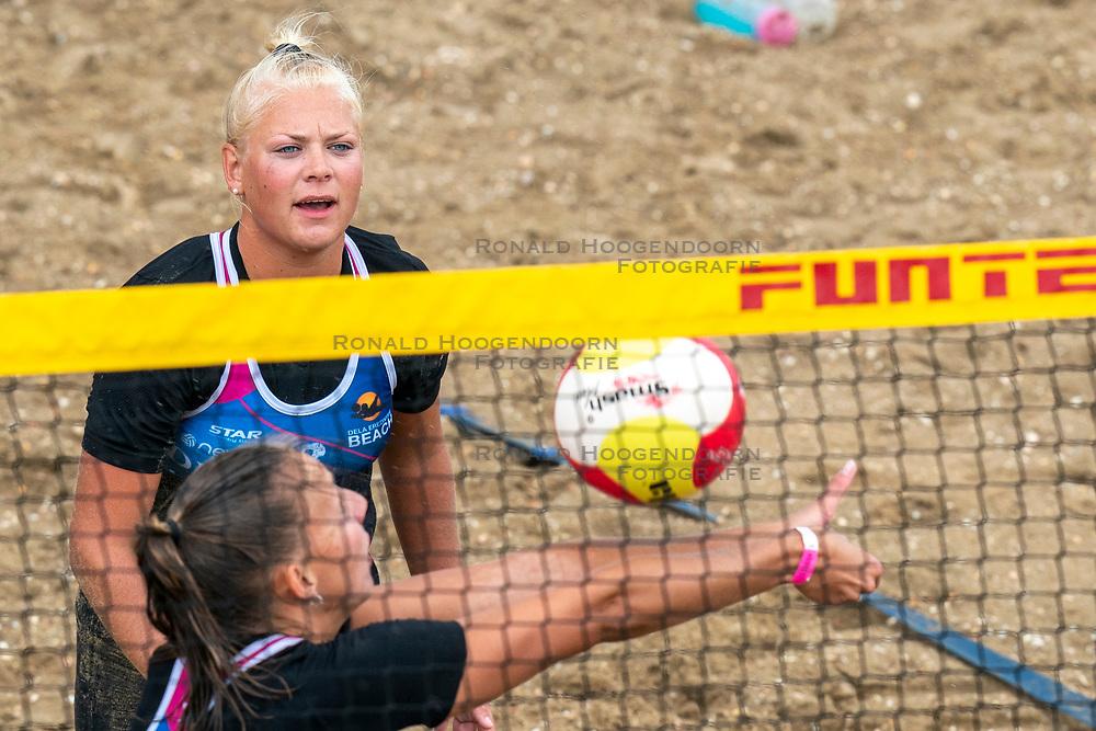 Katja Stam, Raïsa Schoon in action. The DELA NK Beach volleyball for men and women will be played in The Hague Beach Stadium on the beach of Scheveningen on 22 July 2020 in Zaandam.
