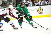 DALLAS, TX - NOVEMBER 1:  Jamie Benn #14 of the Dallas Stars controls the puck from John Mitchell #7 of the Colorado Avalanche on November 1, 2013 at the American Airlines Center in Dallas, Texas.  (Photo by Cooper Neill/Getty Images) *** Local Caption *** Jamie Benn; John Mitchell