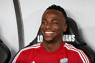 Saido Berahino of West Bromwich Albion looks happy and relaxed as he sits on the replacements bench ahead of kick off. Barclays Premier league match, Swansea city v West Bromwich Albion at the Liberty Stadium in Swansea, South Wales  on Boxing Day Saturday 26th December 2015.<br /> pic by  Andrew Orchard, Andrew Orchard sports photography.