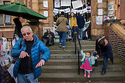 Campaigners on the steps of Carnegie Library in Herne Hill, south London while occupiers remain inside the premises on day 9 of its occupation, 8th April 2016. The angry local community in the south London borough have occupied their important resource for learning and social hub for the weekend. After a long campaign by locals, Lambeth have gone ahead and closed the library's doors for the last time because they say, cuts to their budget mean millions must be saved.