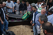 Mourners prepare to bury the body of a minor killed by an explosion caused by an electrical fault in a mine in rural Turkey. Soma, Western Turkey.