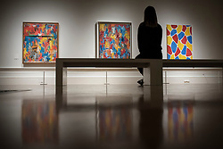 "© Licensed to London News Pictures. 19/09/2017. London, UK. A visitor views (L to R) ""Painting With Two Balls"", 1960, ""False Start"", 1959, and ""Nines"", 2006, all by Jasper Johns.  Preview of a landmark exhibition by Jasper Johns RA called ""Something Resembling Truth"" at the Royal Academy of Arts in Piccadilly.  Sculptures, drawing, prints plus new works are on display 25 September to 10 December 2017.   Photo credit : Stephen Chung/LNP"