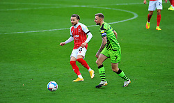 Alfie May of Cheltenham Town competes with Carl Winchester of Forest Green Rovers- Mandatory by-line: Nizaam Jones/JMP - 31/10/2020 - FOOTBALL - Jonny-Rocks Stadium - Cheltenham, England - Cheltenham Town v Forest Green Rovers - Sky Bet League Two