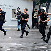 A Turkish riot policemans fires tear gas during clashes with police on Istiklal Avenue in Istanbul, Turkey, on July 6, 2013. Photo by AYKUT AKICI/TURKPIX