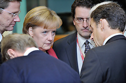 """Angela Merkel, Germany's chancellor, left, speaks with Nicolas Sarkozy, France's president, during the European Union Summit at the EU headquarters in Brussels, Belgium, on Friday, Oct. 30, 2009. European Union leaders are set for """"very difficult"""" talks to overcome the Czech Republic's resistance to a new governing treaty designed to strengthen the EU's influence in world affairs, Reinfeldt said. (Photo © Jock Fistick)"""