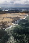 Nederland, Zuid-Holland, Gemeente Westland, 22-05-2011; Zandmotor, aanleg van kunstmatig schiereiland door het opspuiten van zand voor de kust ter hoogte van Ter Heijde. Wind, golven en stroming zullen het zand langs de kust verspreiden waardoor breder stranden en duinen ontstaan. De zandmotor is een experiment in het kader van kustonderhoud en kustverdediging. In de achtergrond de kassen van het Westland..Sand Engine, construction of artificial peninsula by the raising of sand for the coast of Ter Heijde (near the Hague). Wind, waves and currents will distribute the sand along the coast yielding wider beaches and dunes along the coastline . The Sand Engine is a experiment for coastal maintenance of coastal defense. In the background the Westland greenhouses..luchtfoto (toeslag); aerial photo (additional fee required); .foto Siebe Swart / photo Siebe Swart