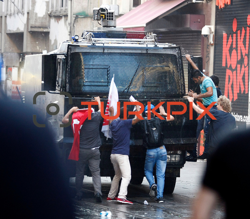 A Turkish protesters confronts a police vehicle during an anti-government protest at Taksim Square in Istanbul, Turkey, 06 July 2013. Turkish police used tear gas and water cannon against peaceful protesters on Istanbul's Taksim Square on 06 July after the city's governor banned a planned evening demonstration. Photo by AYKUT AKICI/TURKPIX