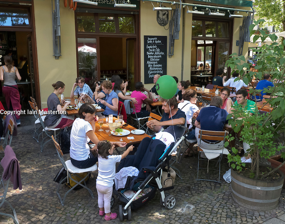 Busy pavement cafe serving brunch on a weekend morning in Prenzlauer Berg in Berlin Germany