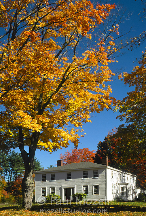 Old white house with fall colors, North Conway, New Hampshire
