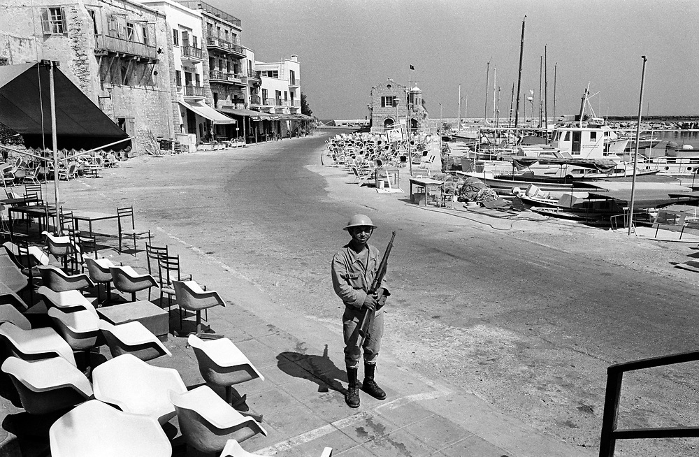 Cyprus War 20 July-18 August 1974. Turkish invasion of Cyprus code-name by Turkey, Operation Attila. A Turkish soldier guards the harbour at the northern Cyprus town of Kyrenia shortly after the invasion July 1974. A Turkish flag flies on a nearby building. Photo by Terry Fincher.