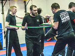 John holds the hoop, Stef Noij, KMG Instructor from the Institute Krav Maga Netherlands, at the IKMS G Level Programme seminar today at the Scottish Martial Arts Centre, Alloa.