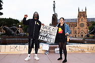 Rodney Overby former Sydney King Basketball player and Kira Dargin at Hyde Park during a 'Black Lives Matter' rally on 02 June, 2020 in Sydney, Australia. This event was organised to rally against aboriginal deaths in custody in Australia as well as in unity with protests across the United States following the killing of an unarmed black man George Floyd at the hands of a police officer in Minneapolis, Minnesota. (Photo by Steven Markham/ Speed Media)