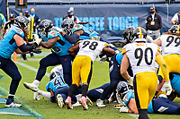 NASHVILLE, TN - OCTOBER 25:  Derrick Henry #22 of the Tennessee Titans dives over the pile into the end zone during a game against the Pittsburgh Steelers at Nissan Stadium on October 25, 2020 in Nashville, Tennessee.  The Steelers defeated the Titans 27-24.  (Photo by Wesley Hitt/Getty Images) *** Local Caption *** Derrick Henry