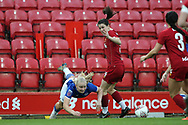 Everton women forward Elise Hughes (9) goes down under the challenge  from Liverpool women defender Niamh Fahey (5) during the FA Women's Super League match between Liverpool Women and Everton Women at Anfield, Liverpool, England on 17 November 2019.