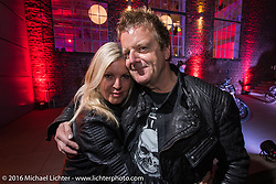Fred Kodlin and Jelena Billo having a great evening Intermot sponsored party at the very cool New Yorker / Dock One warehouse after another day at the Intermot Motorcycle Trade Fair. Cologne, Germany. Thursday October 6, 2016. Photography ©2016 Michael Lichter.