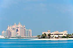 Luxury villas and Atlantis Hotel on Palm Jumeirah artificial island in Dubai in United Arab Emirates