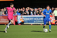 AFC Wimbledon midfielder Dean Parrett (18) running away from Southend United midfielder Anthony Wordsworth (4) during the EFL Sky Bet League 1 match between AFC Wimbledon and Southend United at the Cherry Red Records Stadium, Kingston, England on 25 March 2017. Photo by Matthew Redman.
