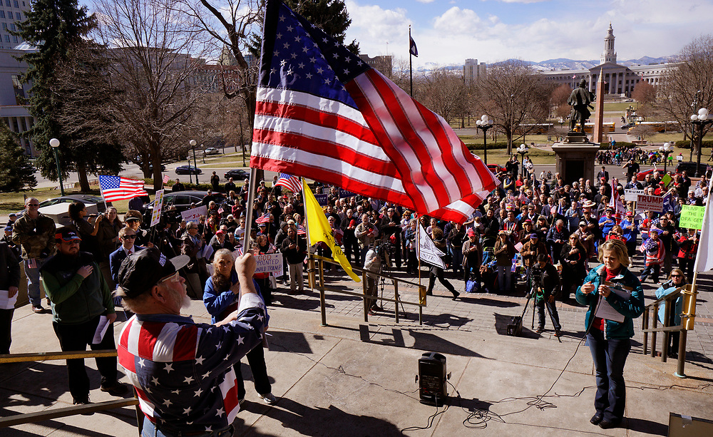 """Supporters of U.S. President Donald Trump recite the pledge of allegiance at a """"Spirit of America"""" rally in Denver February 27, 2017.   REUTERS/Rick Wilking"""