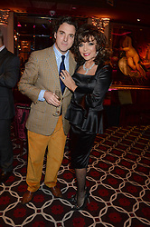 JOAN COLLINS and her son SACHA NEWLEY at a party to celebrate the publication of 'Passion for Life' by Joan Collins held at No41 The Westbury Hotel, Mayfair, London on21st October 2013.