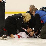 Alihan Demirer, Turkey, is treated by medical staff while injured on the ice during the Turkey V Bulgaria match during the 2012 IIHF Ice Hockey World Championships Division 3 held at Dunedin Ice Stadium. Dunedin, Otago, New Zealand. 21st January 2012. Photo Tim Clayton