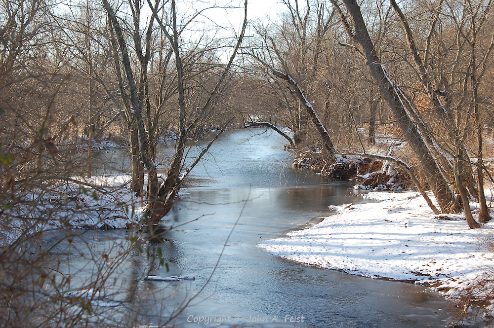Water flows past the last snow between the river and the D and R canal