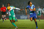 Plymouth Argyle forward Freddie Ladapo (19) goes past Wycombe Wanderers defender Sido Jombati(2) during the EFL Sky Bet League 1 match between Wycombe Wanderers and Plymouth Argyle at Adams Park, High Wycombe, England on 26 January 2019.